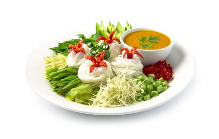 Rice Thin Noodles with Fish Curry Sauce in coconut milk on Bowl side dish (Khanom Jeen Num Ya) Thai food style decorate with vegetables and carved chili side view Reklamní fotografie