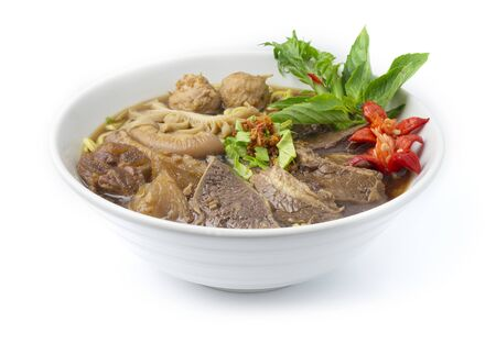 Thin Noodles with Braised Stewed Mix Beef in Chinese herb soup (kuay taiw nuae toon) Thai food dish decorate with vegetables style side view