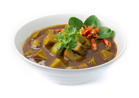Thai Fish Organs Sour Curry Soup with Long Bean,Bamboo shoot,eggplants cutlet Thai food Southern style decorate with Kaffer lime leaf and chili carved side view