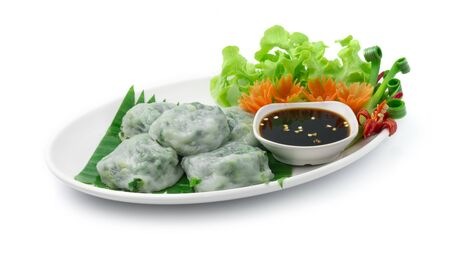 Chinese chives Dumplings or Garlic Chives Dim Sum Rice Cake inside garlic chives cutlet Steamed Served Sweet Black Soy Sauce Chinese Food Appetizer dish Style side view