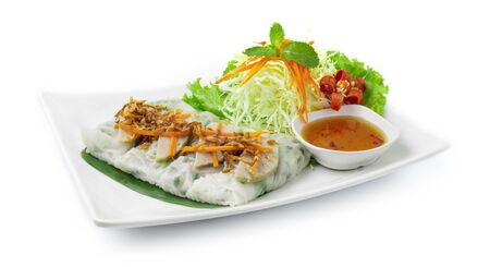 Rice flour Rolls Stuffed with ground pork and green onion ontop with Vietnamese Pork Saucesage Served with sweet dipping sauces  Vietnamese Food style decorate with carved vegetables and chili healthy food side view Stock Photo