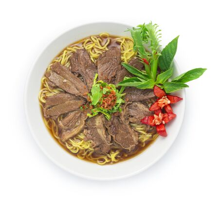 Egg Noodles with Braised Stewed Beef in Chinese herb soup (kuay taiw nuae toon) Thai food dish decorate with vegetables style top view