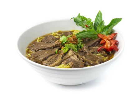Egg Noodles with Braised Stewed Beef in Chinese herb soup (kuay taiw nuae toon) Thai food dish decorate with vegetables style side view
