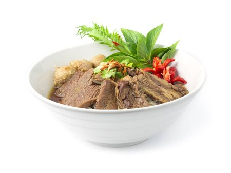 Vermicelli Noodles with Braised Stewed Beef in Chinese herbs soup (kuay taiw nuae toon) Thai food dish decorate with vegetables style side view