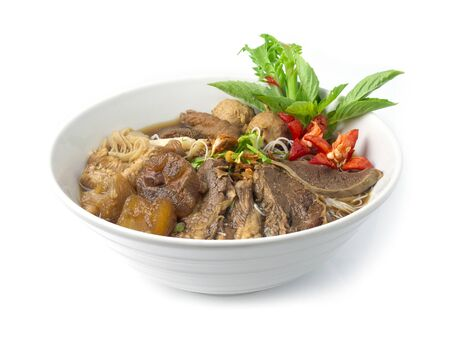Vermicelli Noodles with Braised Stewed Mix Beef in Chinese herbs soup (kuay taiw nuae toon) Thai food dish decorate with vegetables style side view