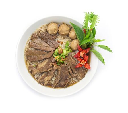 Vermicelli Noodles with Braised Stewed Beef in Chinese herbs soup (kuay taiw nuae toon) Thai food dish decorate with vegetables style