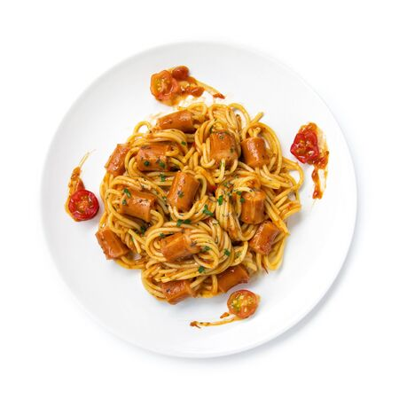 Spaghetti Bolognese with saucesage in tomato sauce topped chopped leaf basil sprinkle fusion food Italian traditional style decorate with carved tomato cherry top view
