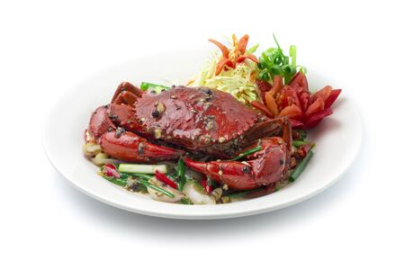 Stir Fried Crab with Black Pepper Sauce and Spring onions. Thai Food and Asian Food fusion style decorate vegetables carved tomato side view