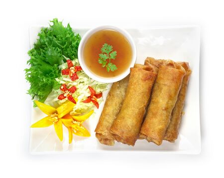 Vegetables Spring Roll deep fried Thai food fusion with Chinese style decorate with vegetables and sweet chili sauce top view Stock Photo