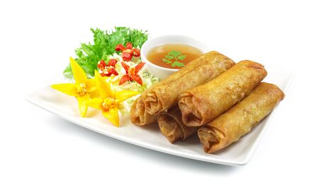 Vegetables Spring Roll deep fried Thai food fusion with Chinese style decorate with vegetables and sweet chili sauce side view Stock Photo