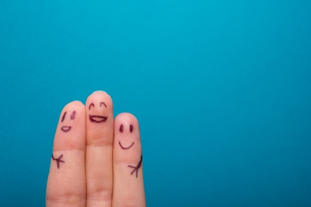 three smiling fingers that are very happy to be friends, family concept Фото со стока