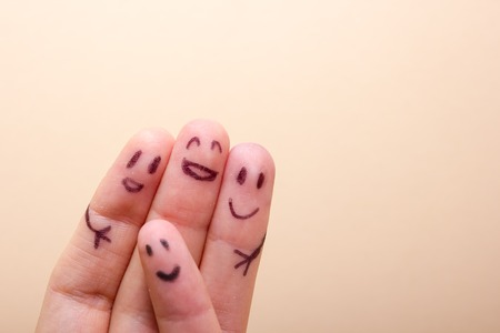 three smiling fingers that are very happy to be friends, family concept Stock Photo