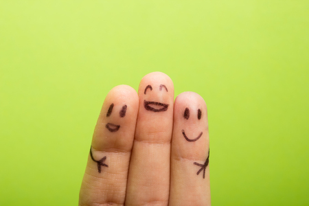 work icons: three smiling fingers that are very happy to be friends, family concept Stock Photo