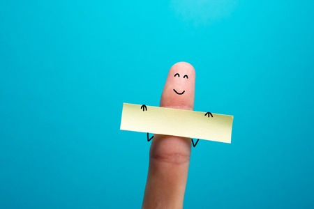 smile happy: Funny finger holding blank bunner and smiling.