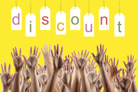 hands lifted up: Discount word on labels over yellow gradient background, peoples hands lifted up in the air.. Sale poster. Festive backdrop poster on Black Friday theme with copy space and clipping pass