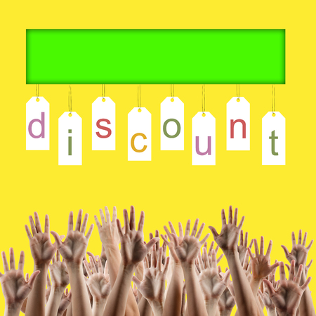 hands lifted up: Black friday. Discount word on labels over yellow gradient background, peoples hands lifted up in the air. Sale poster. Festive backdrop poster on Black Friday theme with copy space and clipping pass Stock Photo