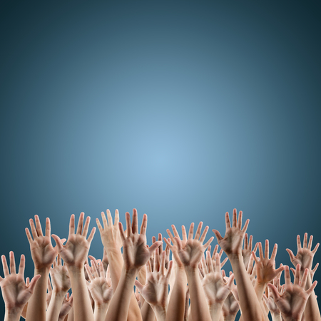 hands lifted up: Many peoples hands up on blue background. Various hands lifted up in the air. Clipping path. Copy space.
