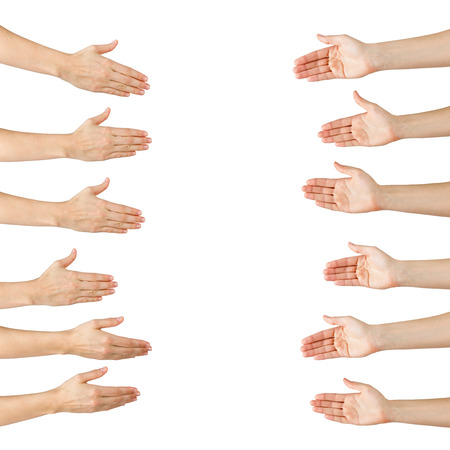 gesture: Various female hands offering handshake isolated on white background, copy space, clipping pass. Closeup picture of woman shaking hands Stock Photo