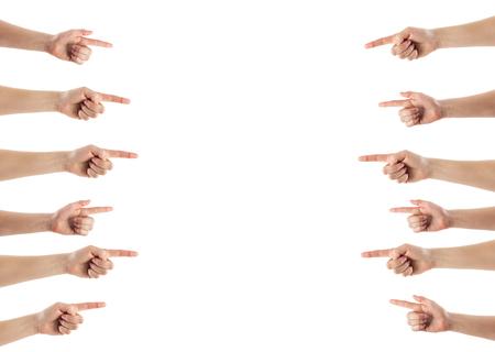 dedo indice: tocar la mano femenina o que señala algo aislado en el fondo blanco. Foto de archivo