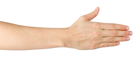 Female hand offering handshake isolated on white background, copy space, clipping pass. Closeup picture of woman shaking hand Stock Photo
