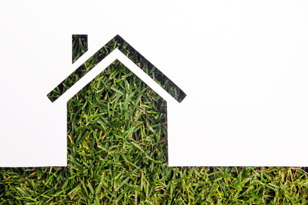 company ownership: Paper house against green background. Real Estate Concept