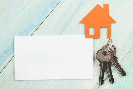 agency agreement: Blank business card with house figure. Real Estate Concept. Top view Stock Photo