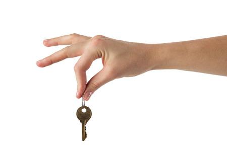 dedo: Cierre de vista de la llave de la mano a una casa de sue�o aislado en blanco. Clipping paso y espacio de la copia. BIENES RA�CES