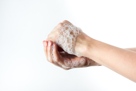 sudsy: gesture of woman washing her hands on white background. Stock Photo