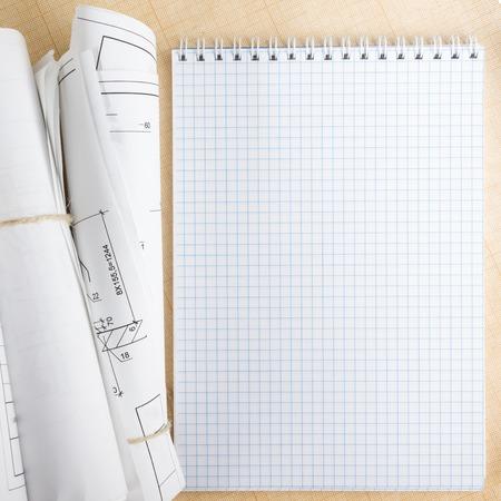 blueprint: Architectural blueprints and blueprint rolls on white background