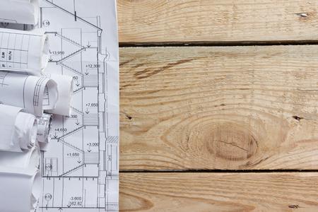 blueprint: Architectural blueprints and blueprint rolls on wooden background