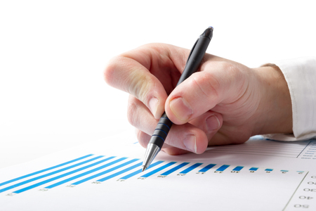 Businessman counting losses and profit working with statistics, analyzing financial the results on white background. Copy space. Stockfoto