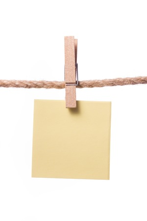 product placement: Blank paper notes hanging on rope with clothes pins, copy space for text or image or product placement. Reminder Stock Photo