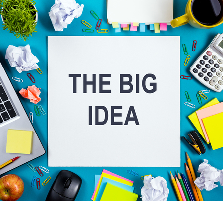 big cork: The big idea text words. Office table with notepad, computer and coffee cup. Business creative consept. Stock Photo