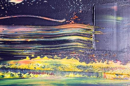 Lienzo pintado abstracto. Pinturas al óleo en una paleta. Fondo colorido.