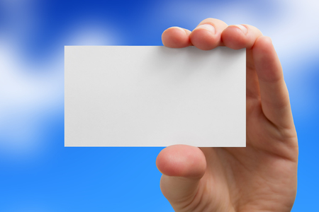 Hand holding white business card on blurred background. Archivio Fotografico