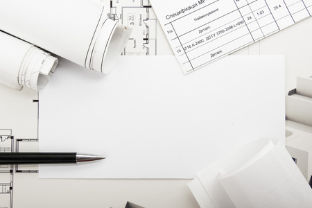 architecture detail: Architectural blueprints and blueprint rolls on white background