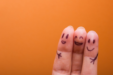 three smiling fingers that are very happy to be friends, family concept 写真素材
