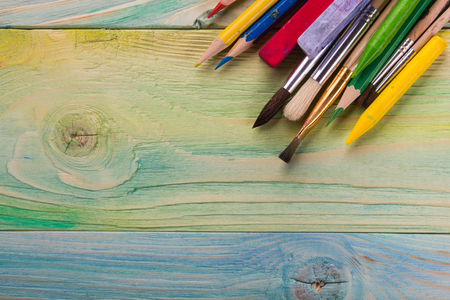 green artistic: Artistic. Used artist paintbrushes on wood background. Back to school, copy space. Education background.