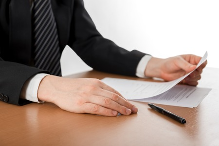 Businessmans hand signing papers. Lawyer, realtor, businessman sign documents on white background. Copy space for text