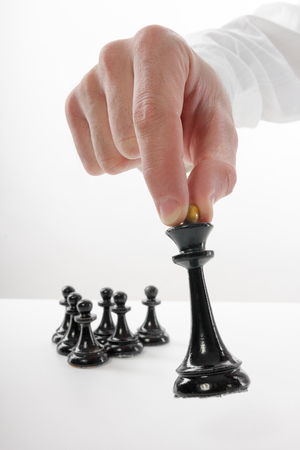 Business concept strategy, leadership, team and success. Businessman playing chess game selective focus. Makes first move