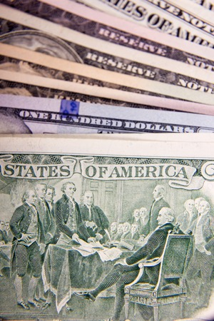 one hundred dollars: Bribe in businessmens pocket. One hundred dollars banknote