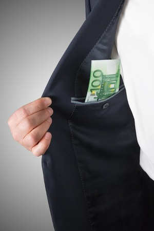 hands on pocket: Businessmans hands counting money euro banknotes in the pocket.