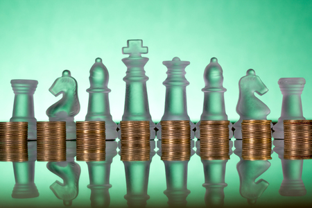 finance concept: Chess on a golden coins. Investment strategy. Finance concept