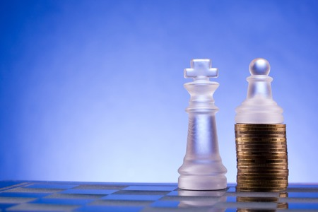 growing partnership: Chess on a golden coins. Investment strategy. Finance concept