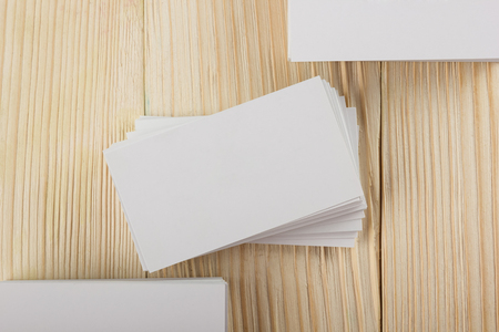 identification card: White blank business visit card, gift, ticket, pass, present close up on wooden background. Copy space Blank corporate identity package business card Template for ID Stock Photo