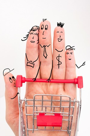 Funny fingers shopping at supermarket with red trolley on white background. Stock Photo