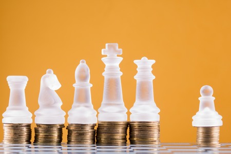 intelligent partnership: Chess on a golden coins. Investment strategy. Finance concept