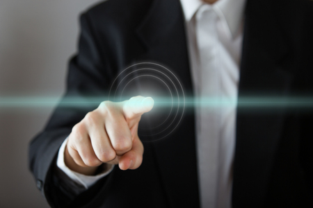 Businessman's hand pressing the virtual screen. Business, technology, internet and networking concept. Copy space.