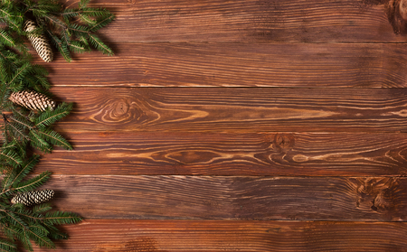 Christmas rustic background - vintage planked wood with lights and free text space. Stock Photo
