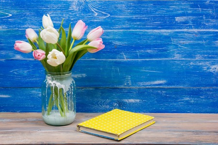many thanks: Beautiful pink flowers tulips on blue wooden desk table. Copy space. Stock Photo
